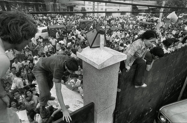 South Vietnamese civilians scaled the 14-foot wall of the US embassy in Saigon,