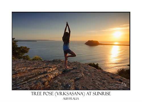 Yoga by the Sea at sunrise - Tree Pose Vrksasana