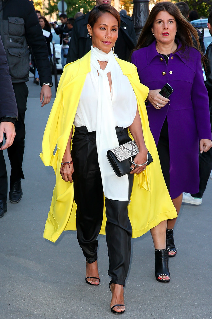yellow-duster-coats-black-trousers-white-pussybow-bouse-snake-print-bag-monochrome-look