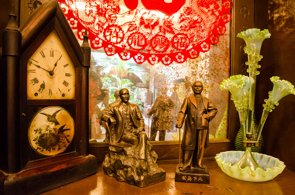 Old clock and Dr Sun Yat-Sen figurine