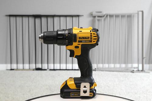 Dewalt yellow power drill with pet gates