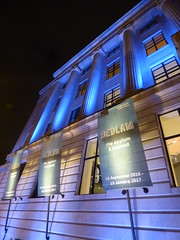 Wellcome Collection - Euston Road, London - blue light and Bedlam banners