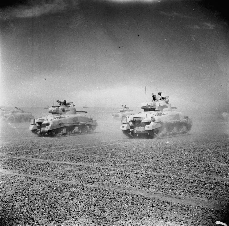 British Eighth Army tanks move across the desert as the Axis forces retreat from El Alamein