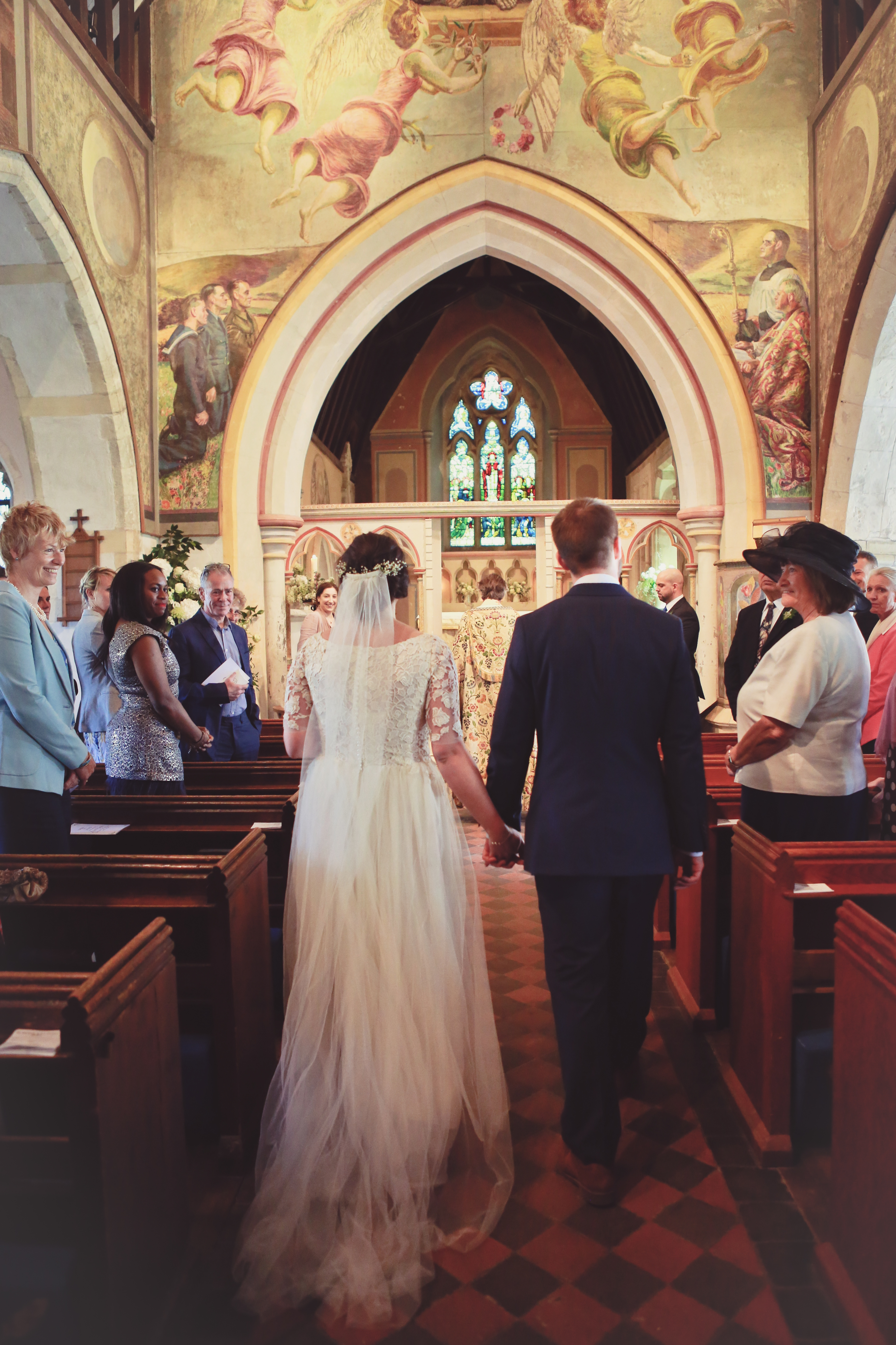 walking up the aisle, church wedding, lace tulle dress