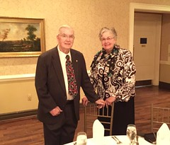 Ed Cody and his wife getting seated for dinner.