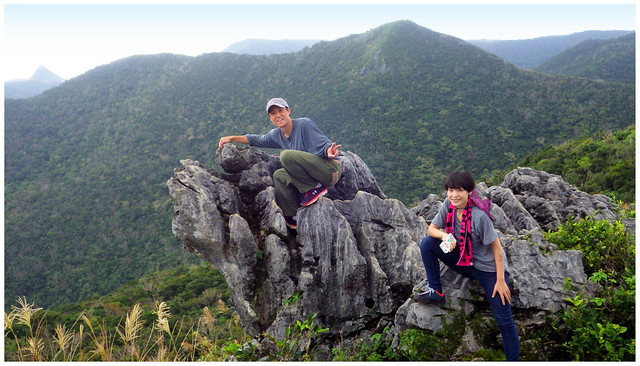 POSING ON A KARST ROCK THAT OVER-HANGS THE SOUTH FACE  OF MT. KATSUU