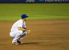 David Wright kneels down