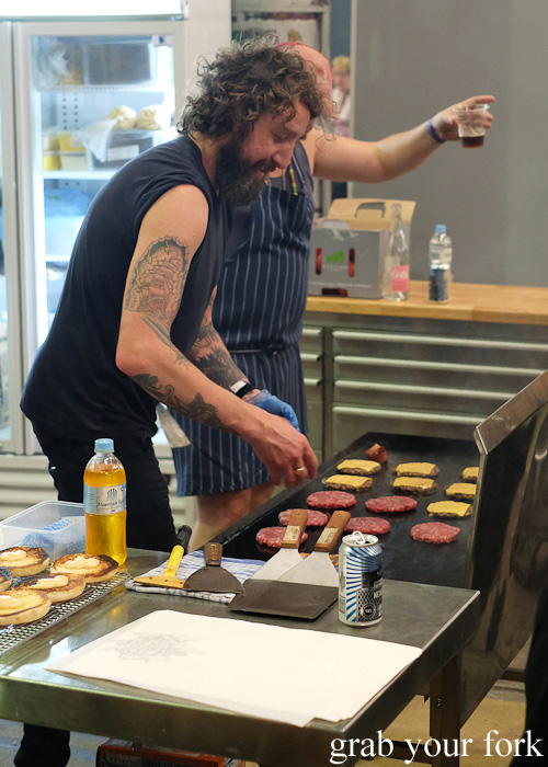 Mary's grilling Lisa burger patties with melted cheese at Rootstock Sydney 2015