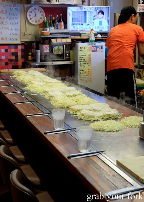 Hiroshimayaki being prepared at Okonomimura, Hiroshima
