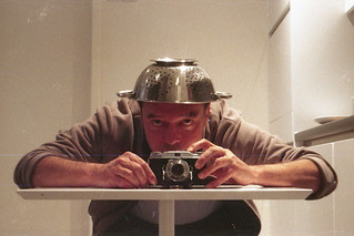 reflected self-portrait with Agfa Solinette II camera and ventilated metal hat