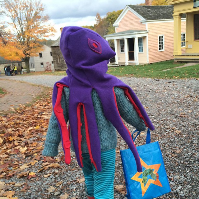 Octopus girl goes trick-or-treating at Genesee Country Village.