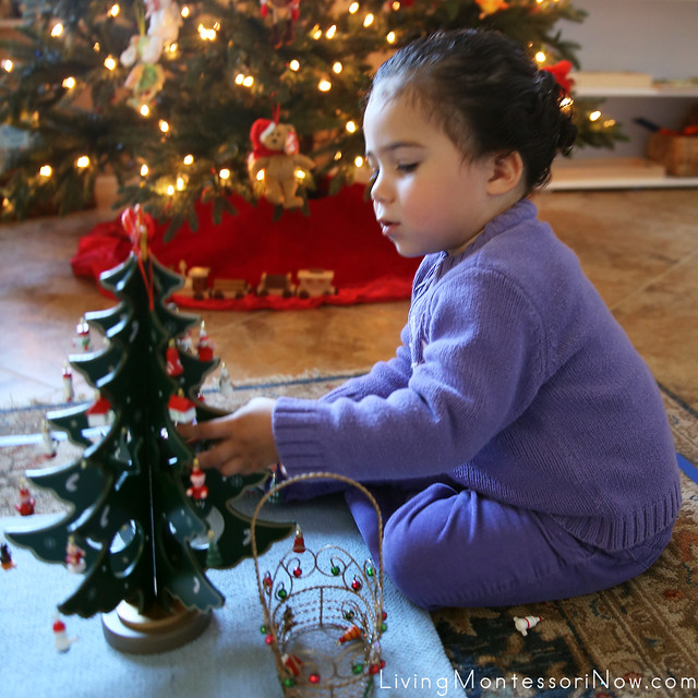 Concentrating on the Montessori Fine-Motor Christmas Tree Activity