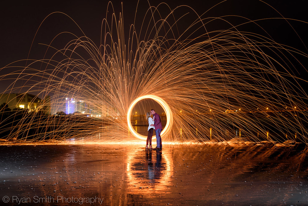 Engagement picture fun spinning steel wool on fire