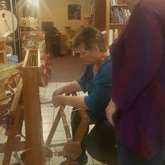 I showed my student Darlene how to tie onto the back apron rod. Her warp is now ready to weave!