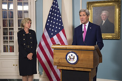 With Ambassador-at-Large, Deborah L. Birx, M.D. looking on, U.S. Secretary of State John Kerry delivers remarks at the U.S. President's Emergency Plan for AIDS Relief (PEPFAR) Diplomatic Reception at the U.S. Department of State in Washington, D.C., on September 2, 2015. [State Department photo/ Public Domain]