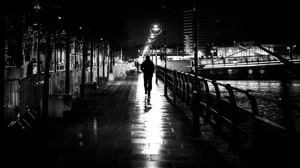 Going home alone dublin ireland black and white street photography