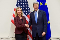 U.S Secretary of State John Kerry shakes hands with European Union High Representative for Foreign Affairs Federica Mogherini on December 1, 2015, at NATO Headquarters in Brussels, Belgium, before a bilateral meeting on the sidelines of a NATO Ministerial meeting. [State Department photo/ Public Domain]