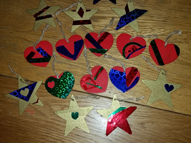 16 Christmas ornaments from wood and self adhesive paper