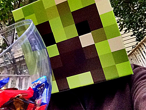 Giving trick or treaters candy in my creeper mask