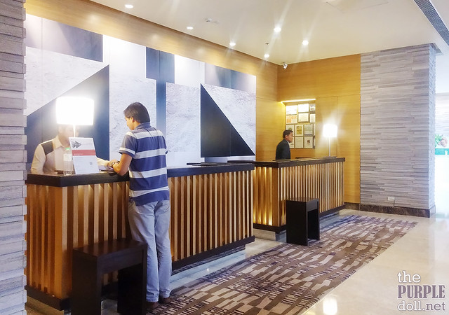 Front Desk on the 4th Floor at Holiday Inn & Suites Makati