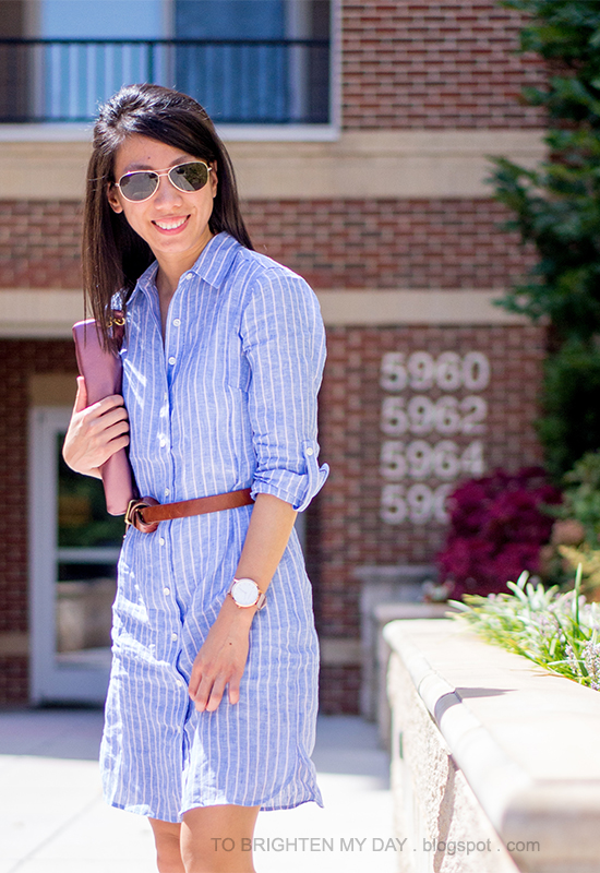 blue and pink striped shirtdress, brown belt, pink metallic clutch, oversized watch