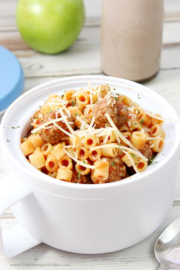 Homemade Spaghetti-O's Recipe in a white bowl with a spoon.