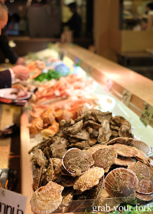Live scallops in the shell at Nanda all-you-can-eat buffet in Sapporo