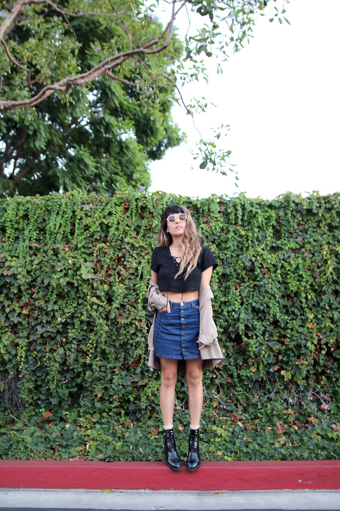 Ark Clothing lace-up top and denim A-line skirt, Zara boots, The Row sunglasses, Nasty Gal Anorak