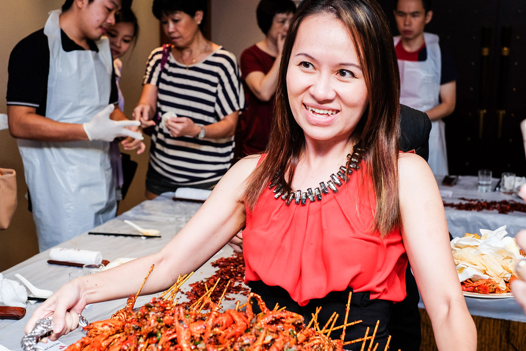Maureen holding huge plate of Baby Lobster at  Si Chuan Dou Hua Restaurant