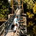 Family Walking on Foot Bridge