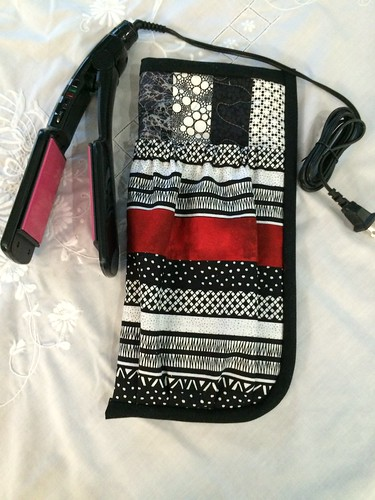 Black (and white with random red) flat iron travel pouch