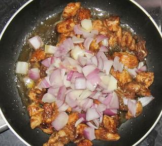 Chicken capsicum - Adding onion pices to chicken