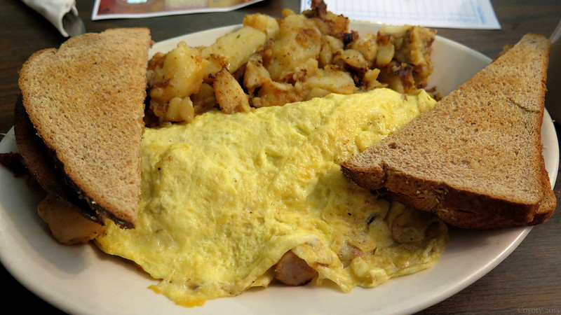 Meat lover's omelet with home fries and wheat toast