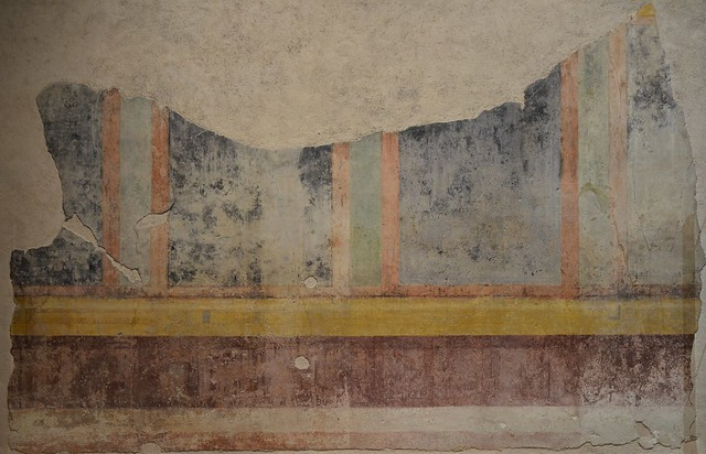 Wall painting fragment which decorated the atrium of the House of Livia alterning wide black and narrow green panels framed in red and bordered above and below in yellow bands, House of Livia, Palatine Hill, Rome