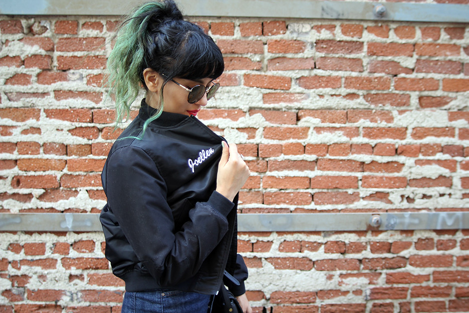 Vans customized name varsity jacket, Hart Denim pencil skirt, The Row round sunglasses, Chinese Laundry boots