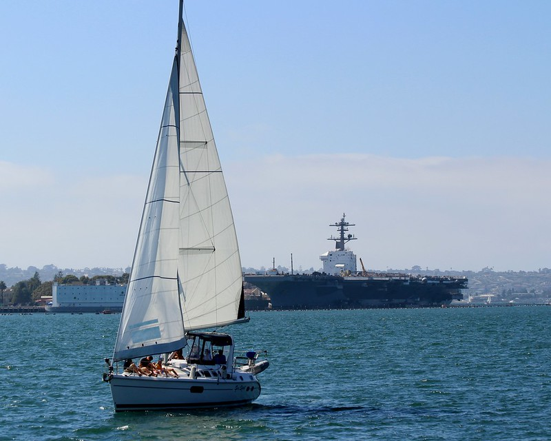 Sail Boat & Nuclear Air Carrier