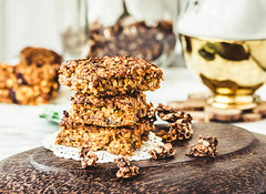 Pumpkin granola bars with peanut butter and seeds,…