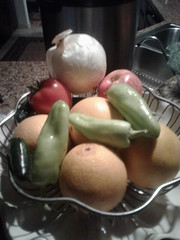 Onion, apple, tomato, oranges, banana peppers and jalapeño peppers.