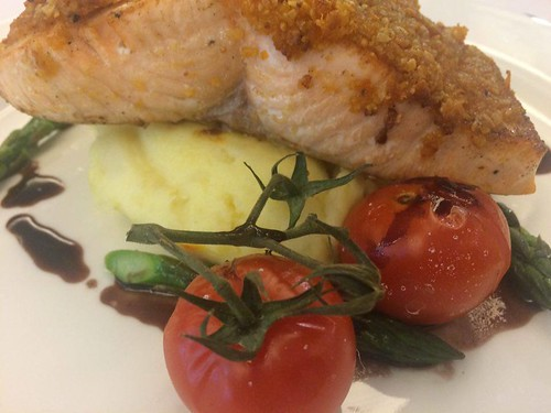 Seared Salmon Supreme, Almond Crusted with aged red wine sauce, caramelised vine ripens tomatoes & asparagus tips