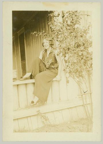 Girl on a porch rail