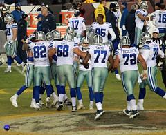 Dallas players congratulate Kicker Dan Bailey on winning field goal.