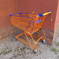 furniture(0.0), wood(0.0), vehicle(0.0), table(0.0), iron(0.0), chair(0.0), shopping cart(1.0), cart(1.0),