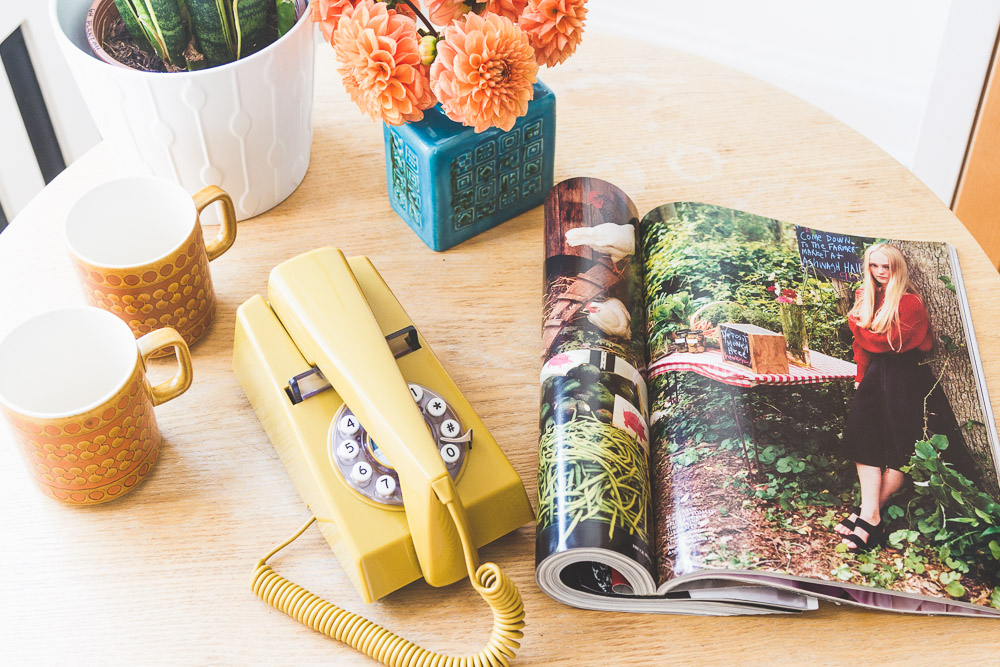 midcentury style colourful home yellow phone flowers