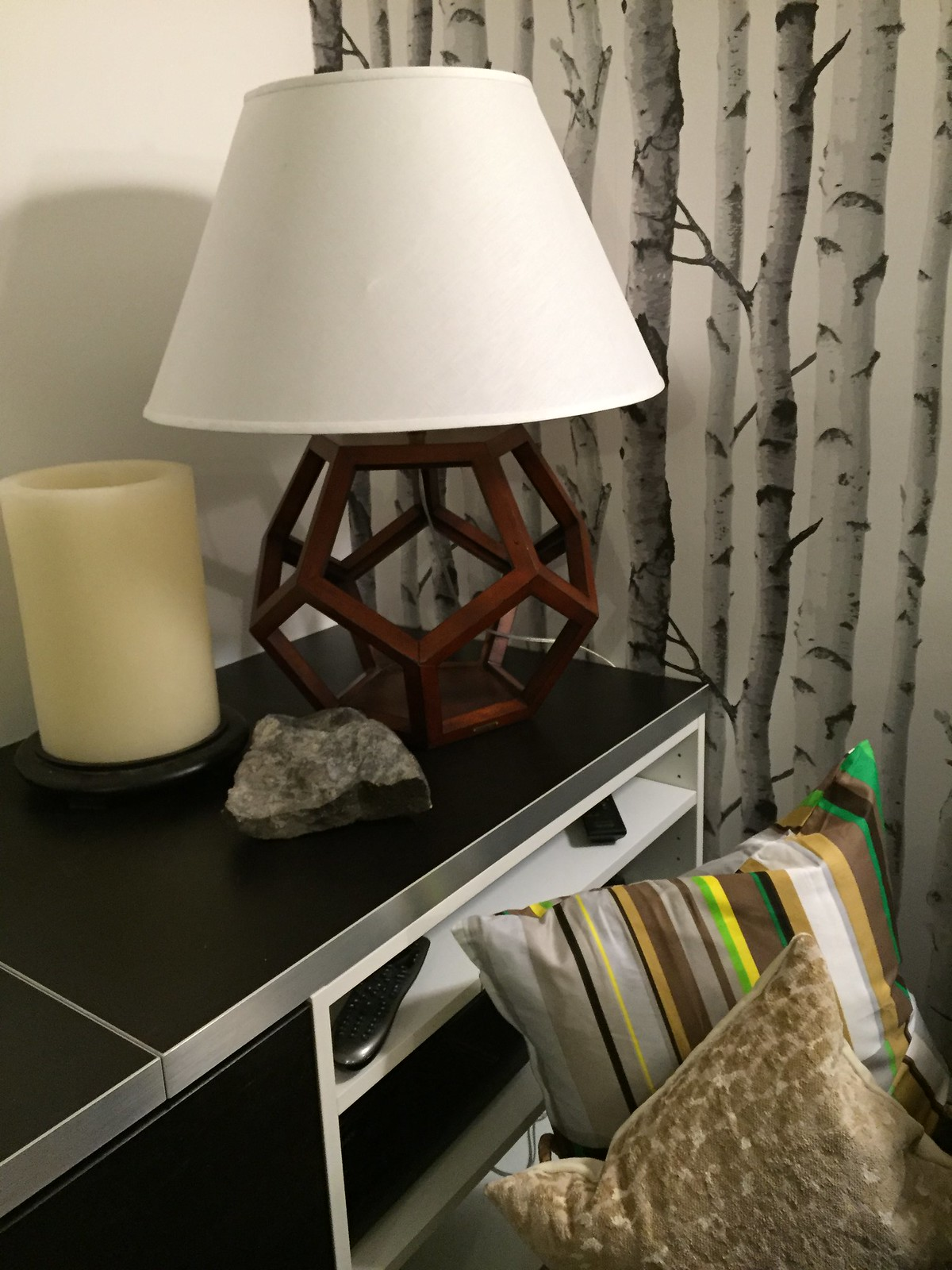 graphic lamp with candle on shelf