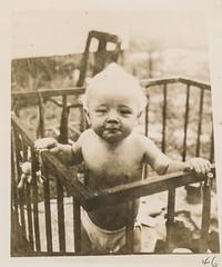 Cute little boy in an outdoor crib 1