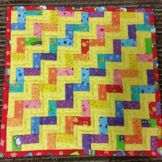 "Miniature rail fence quilt made from left over 2.5"" ×4.5"" subcut pieces of larger rail fence. Bound with backing."