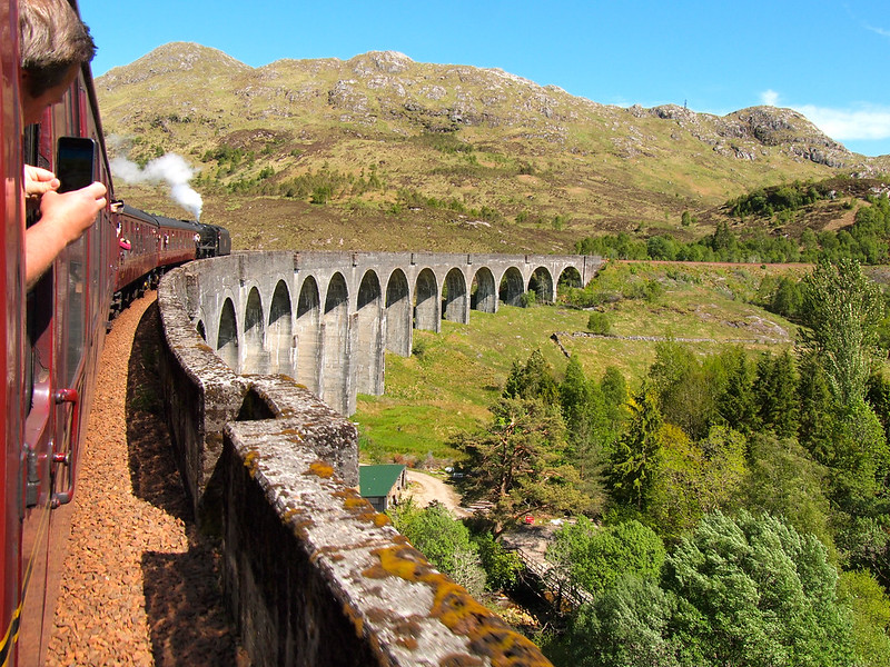 Jacobite Steam Train going over the Glenfinnan Viaduct in Scotland