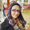 Karen lookin sky in one of Cora's hats. #bewilderknits #uptownfarmersmarket #handmade
