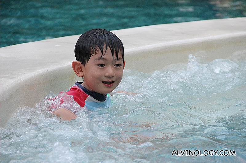 Asher playing in a jacuzzi pool