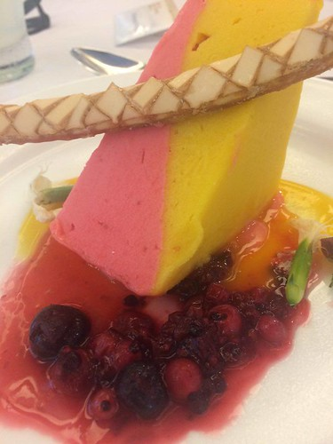 Mango & Raspberry sorbet cake, with a seasonal berry compote with a passionfruit coulis